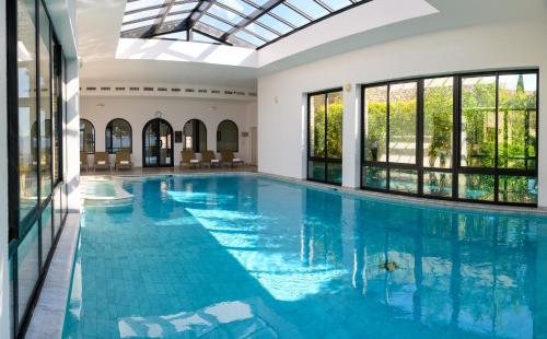 The swimming pool at or near Hotel Les Bories & Spa