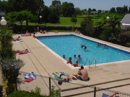The swimming pool at or near Résidence Green Village