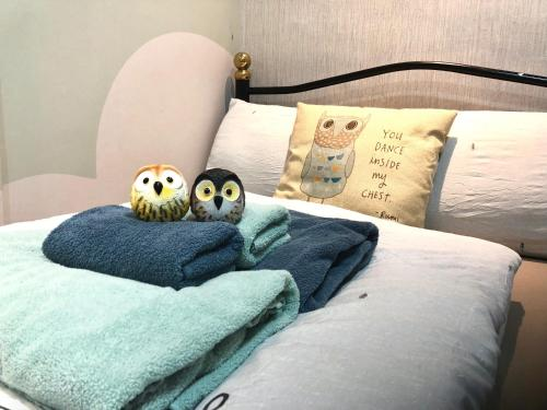 A bed or beds in a room at Owl Hostel