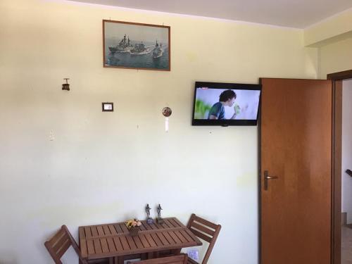 TV o dispositivi per l'intrattenimento presso Appartamento Calisi