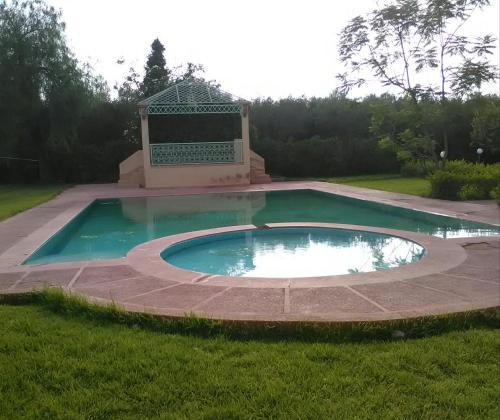 The swimming pool at or near Villa tarif