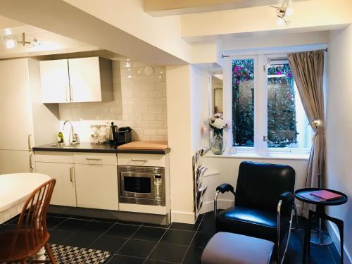 Küche/Küchenzeile in der Unterkunft CoHo Apartment Suites