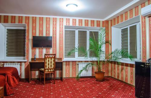 Телевизор и/или развлекательный центр в Гостиница Ностальжи