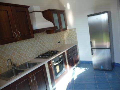 A kitchen or kitchenette at Villa Smeralda