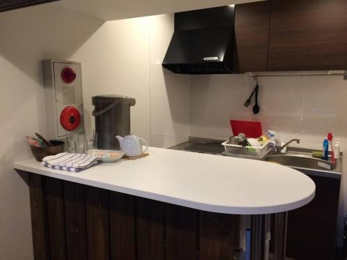 A kitchen or kitchenette at Asuka Guest House