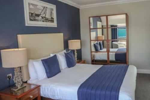 A bed or beds in a room at Haven Hotel