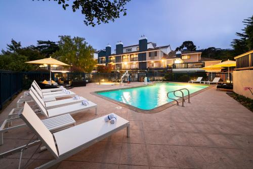 The swimming pool at or near Mariposa Inn and Suites