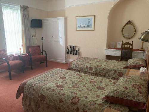 A bed or beds in a room at Green Gables Guest House