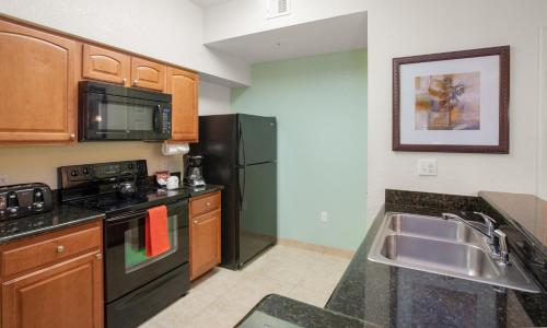 A kitchen or kitchenette at Lake Buena Vista Resort Village and Spa, a staySky Hotel & Resort Near Disney