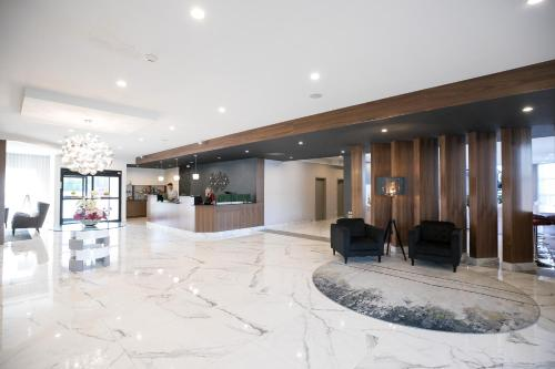 The lobby or reception area at Best Western Plus Montreal East