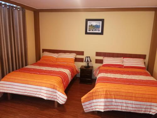 A bed or beds in a room at Nasca Travel One Hostel