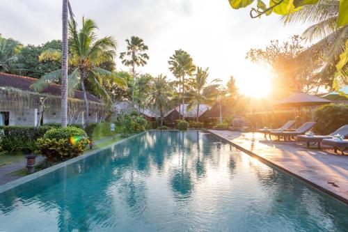 The swimming pool at or near Y Resort Ubud