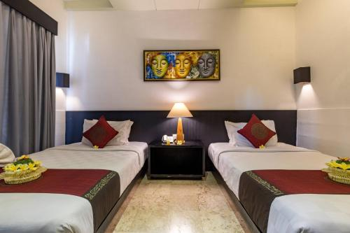 A bed or beds in a room at Y Resort Ubud