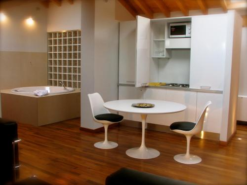 A kitchen or kitchenette at Parizzi Suites & Studio