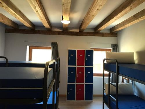 A bunk bed or bunk beds in a room at Albergue Orion