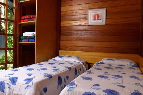 A bed or beds in a room at Estalagem Fazenda Lazer
