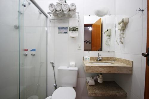 Um banheiro em Carpe Diem Park Hotel