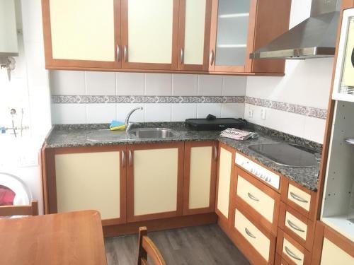 A kitchen or kitchenette at Appartamento turistico