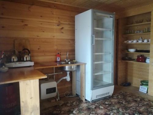 A kitchen or kitchenette at Хостел на Главной, 1
