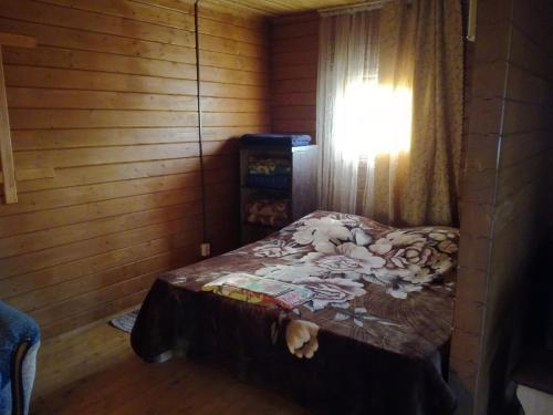 A bed or beds in a room at Хостел на Главной, 1