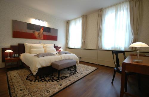 Postelja oz. postelje v sobi nastanitve Hotel Mitra, Story Hotels