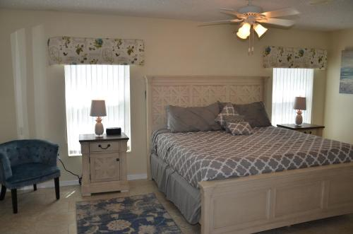 A bed or beds in a room at Disney Lake Front Villa