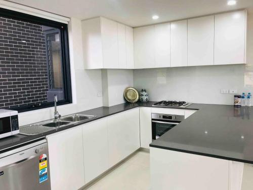 A kitchen or kitchenette at 208 Kalina Apartments 2 Bedrooms
