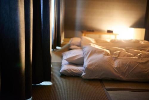 A bed or beds in a room at Sounkyo Onsen Kumoi
