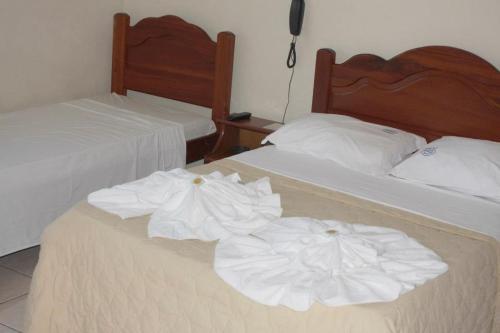 Cama ou camas em um quarto em Pousada Dom Fernandes