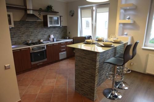 Küche/Küchenzeile in der Unterkunft Apartament-Studio