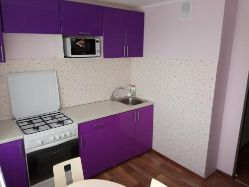 A kitchen or kitchenette at Apartment on Lenina 128