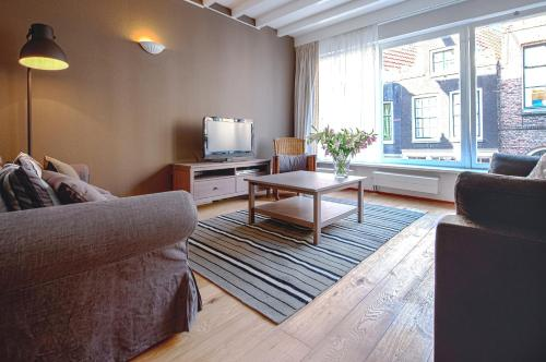 A seating area at Short Stay Group Staalmeesters Serviced Apartments Amsterdam