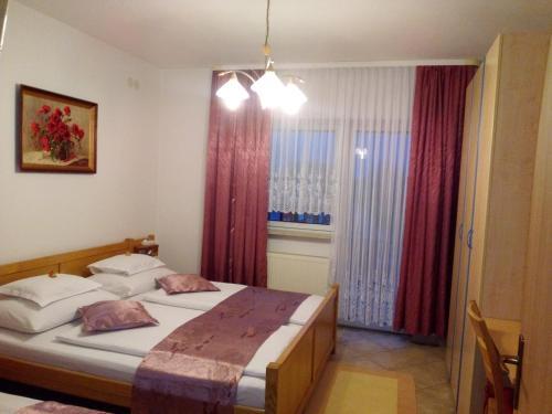 Postel nebo postele na pokoji v ubytování Villa Hodak