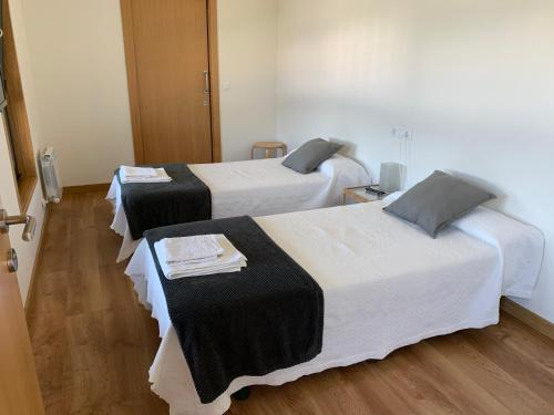 A bed or beds in a room at Linar Do Rei