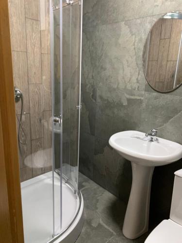 Ванная комната в Mini Hotel Uyut