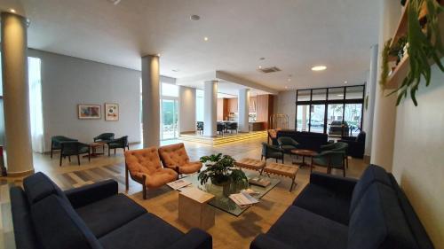 Uma área de estar em Gran Hotel Morada do Sol