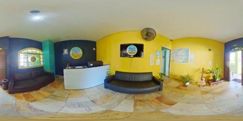 The lobby or reception area at Onça da Praia Hostel