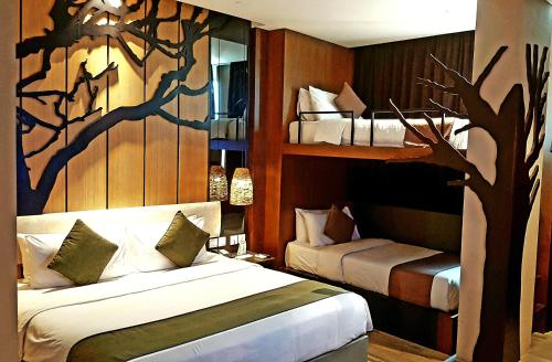 A bed or beds in a room at ESKA Hotel