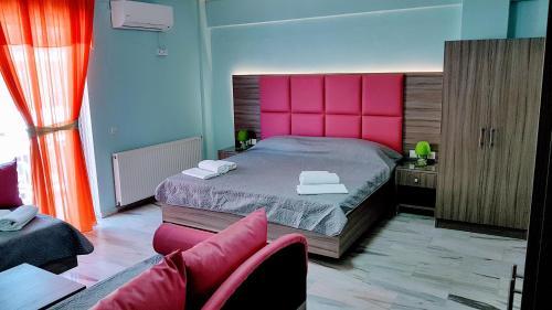 Кровать или кровати в номере Hotel White Rose Beach