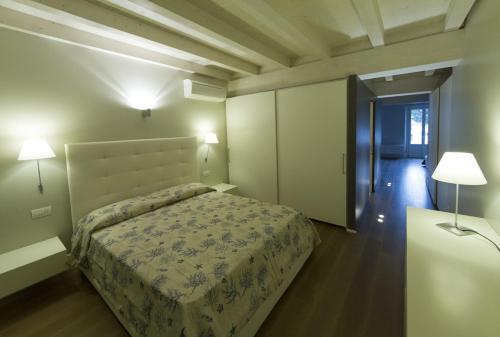Letto o letti in una camera di La Casa Del Porto