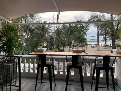 A balcony or terrace at Patong Marina Hotel by Lofty