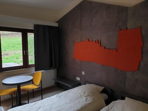 Ein Bett oder Betten in einem Zimmer der Unterkunft Youth Hostel Larochette