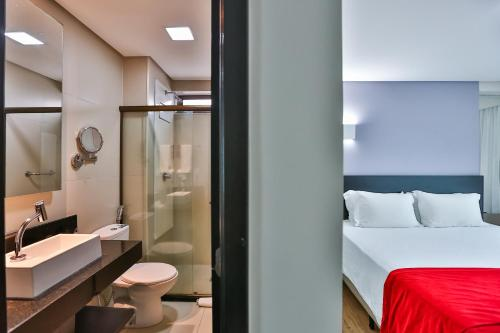 A bathroom at Ramada by Wyndham Recife Boa Viagem