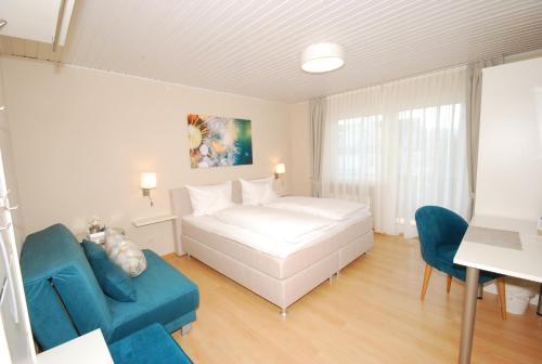 Ein Bett oder Betten in einem Zimmer der Unterkunft Hotel Colosseum