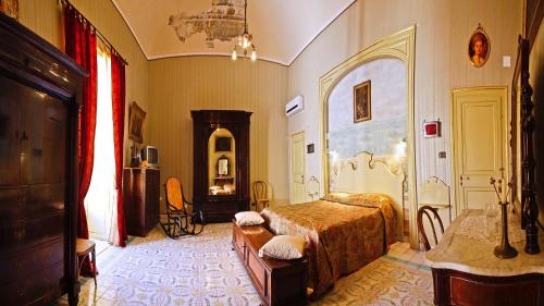 A bed or beds in a room at Casa Barone Agnello