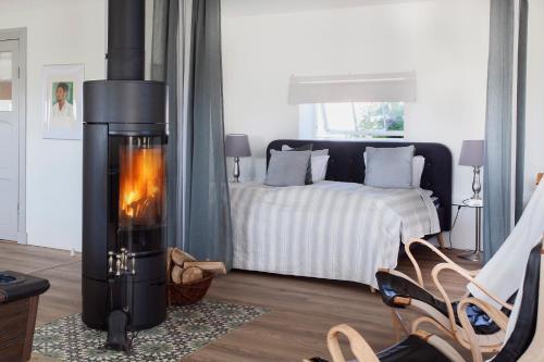 Säng eller sängar i ett rum på Country Suite Malmö