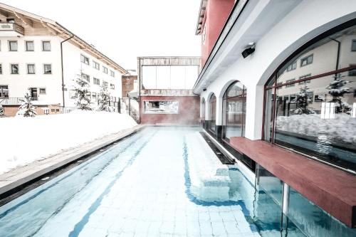 The swimming pool at or near Hotel Rigele Royal Superior