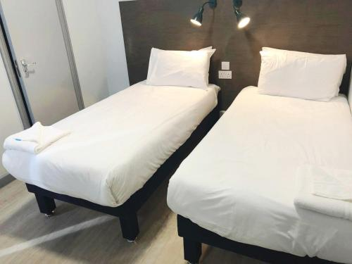 A bed or beds in a room at Euro Hotel Wembley