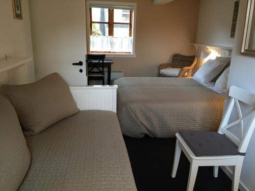 En eller flere senge i et værelse på Pension Klostergaarden Hotel