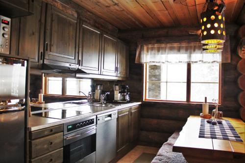 A kitchen or kitchenette at Villa Tunturituuli